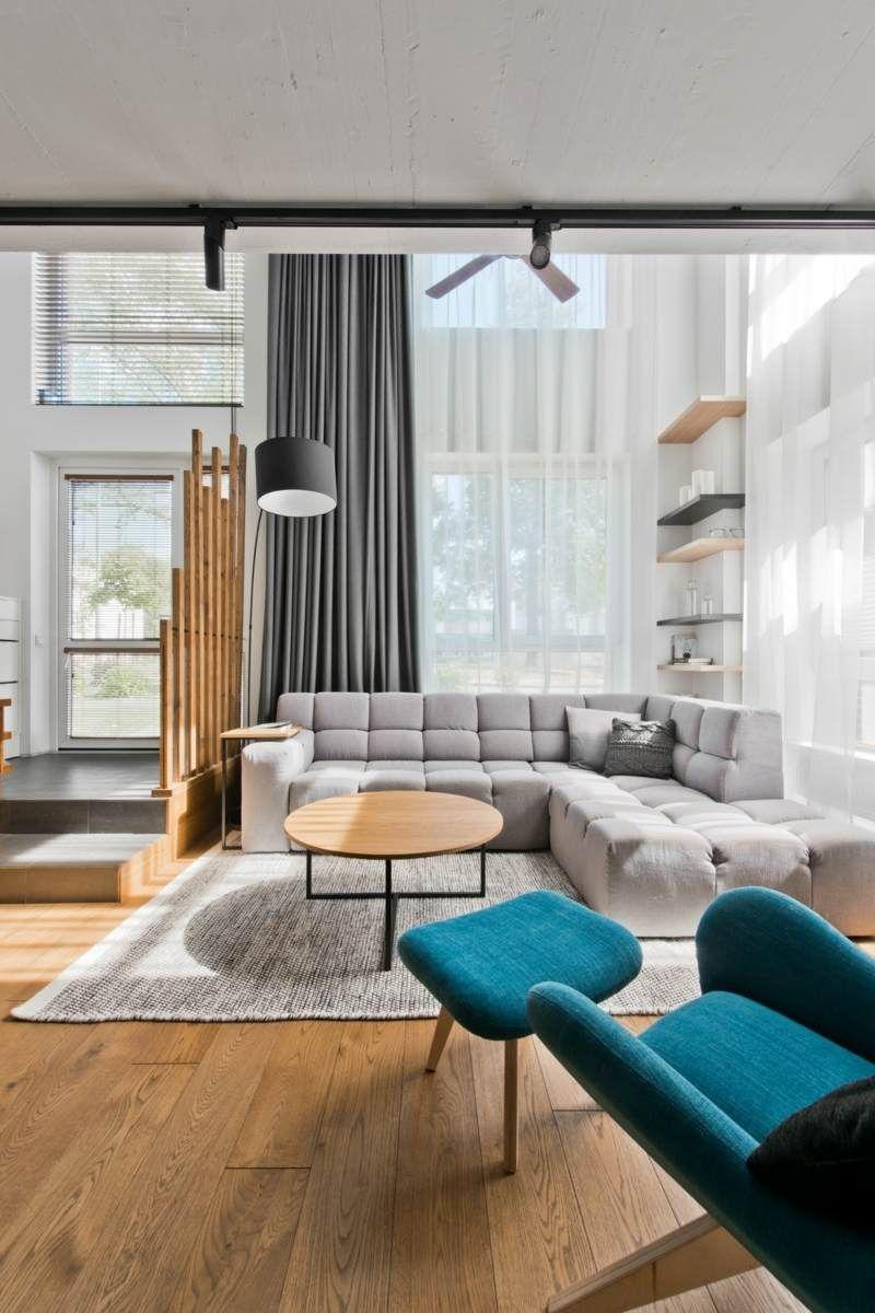 salon scandinave avec fauteuil et repose-pieds sarcelle et canapé ... - Design Meubles Sarcelles