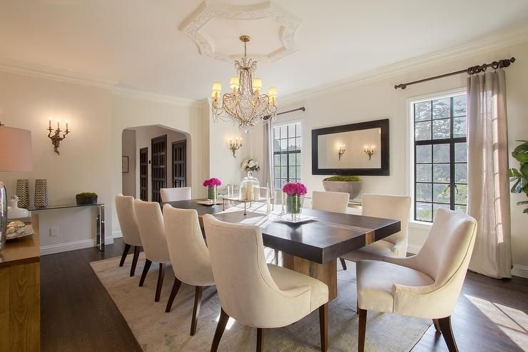 Glamorous Dining Room Features A Crystal Chandelier Illuminating A Captivating Cream Dining Room Furniture Inspiration Design