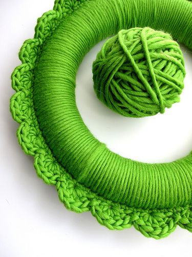 Crochet around a styrofoam wreath and trim it with shell stitch. I made one very similar Dec 2011 in a lighter green with red ribbon running through it. A very easy, fun project.