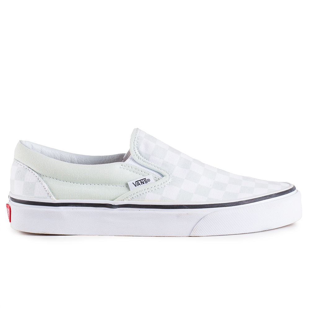 0307a6b913 The Checkerboard Classic Slip-On features sturdy low profile slip-on canvas  uppers made with the iconic Vans checkerboard print