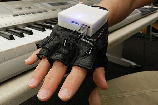 Vibrating glove gives piano lessons, helps rehab patients regain finger sensation, motor skills. Intriguing!