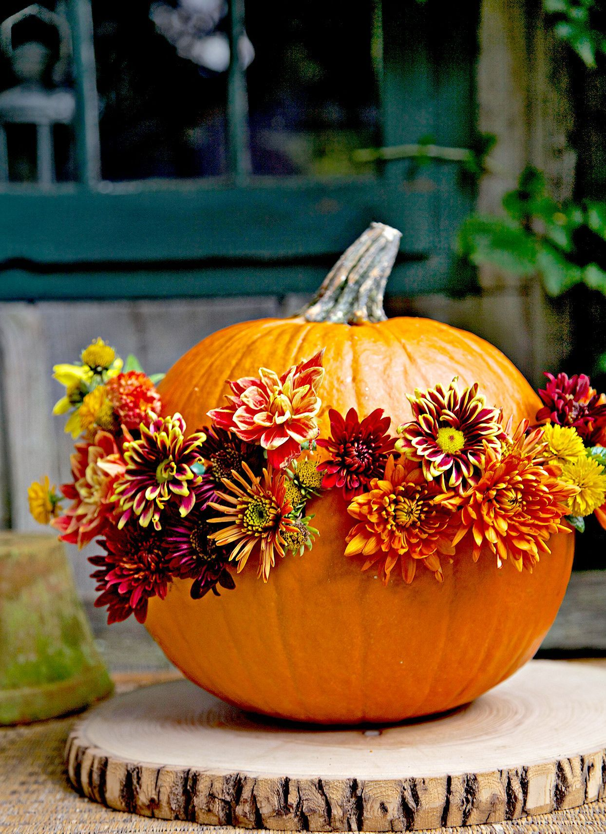 These beautiful fall front porch décor ideas are perfect for fall and Halloween. Whether it's a DIY farmhouse wreath or a harvest-inspired pumpkin display, you're sure to find beautiful fall inspiration for your fall front entry. It's time to update your home with seasonal curb appeal. #fallfrontdoor #porch #curbappeal #halloweendecorideas #outdoor #bhg