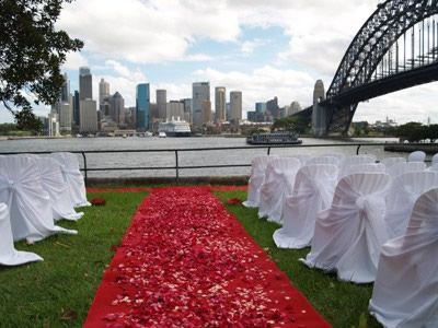 red wedding ideas - outdoor wedding decoration with red carpet