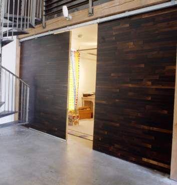 sliding barn doors in a loft for a converted barn feel