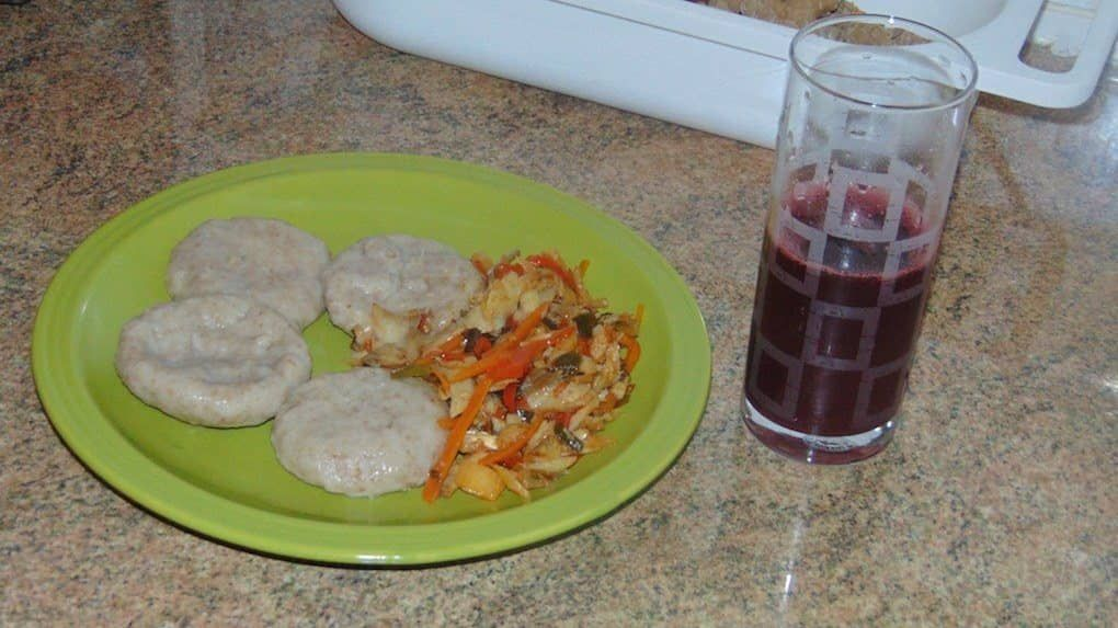 boiled dumpling and saltfish along with sorreal drink