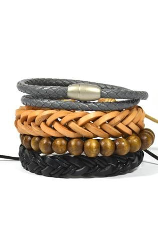 """Product Details - Available in two differentcolor combinations - 5 Piece Set - Includes 10mm and 6mm bamboo wood, 10mm resin beads, 13mm stone skulls, and a pull-closure leather bracelet Color: Black/Brown Material: Wood, Resin, Stone, Leather Measurements: 8""""L Origin: USA"""