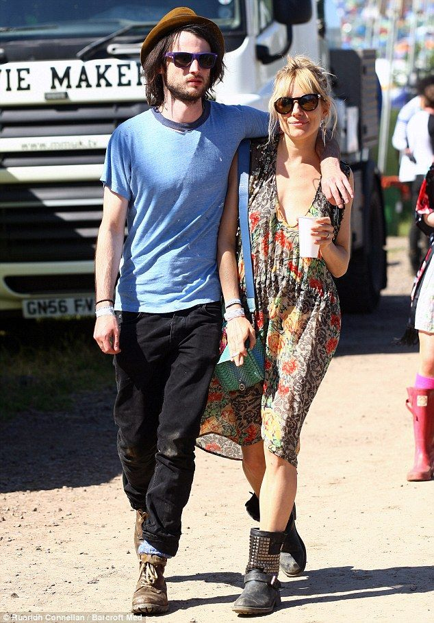 Tom Sturridge and Sienna Miller at the Glastonbury Festival.