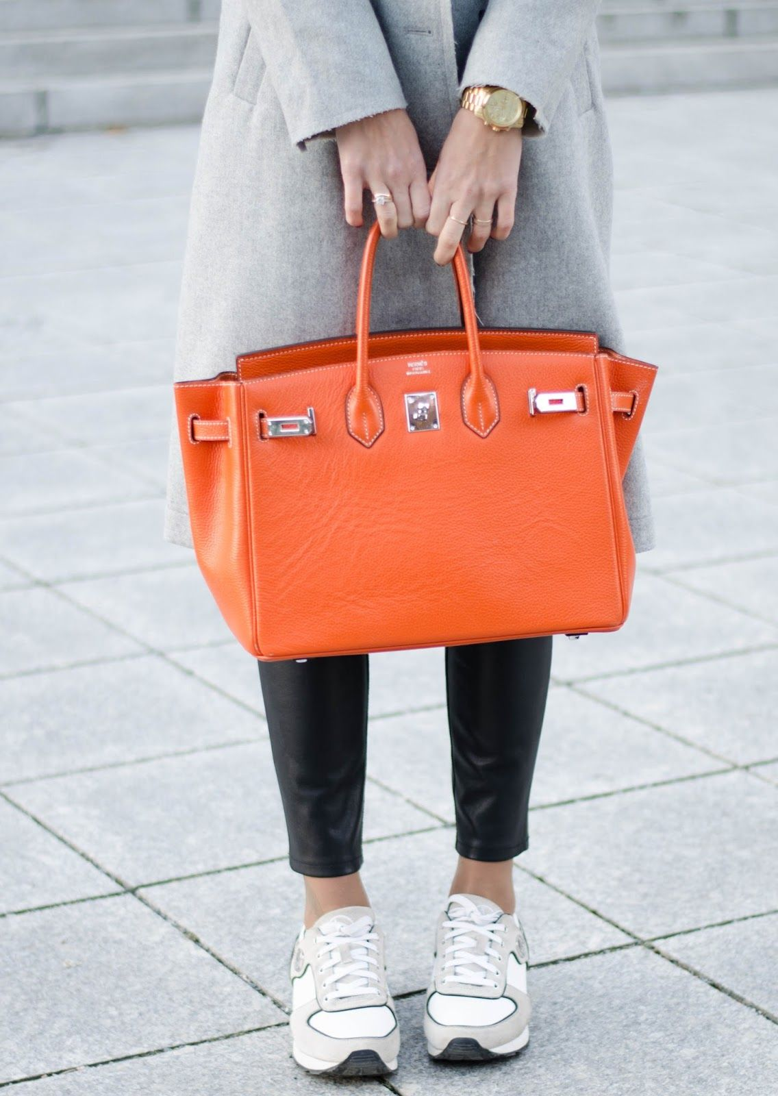 4a1d73e590 kristjaana mere orange hermes birkin bag leather pants white sneakers  winter style