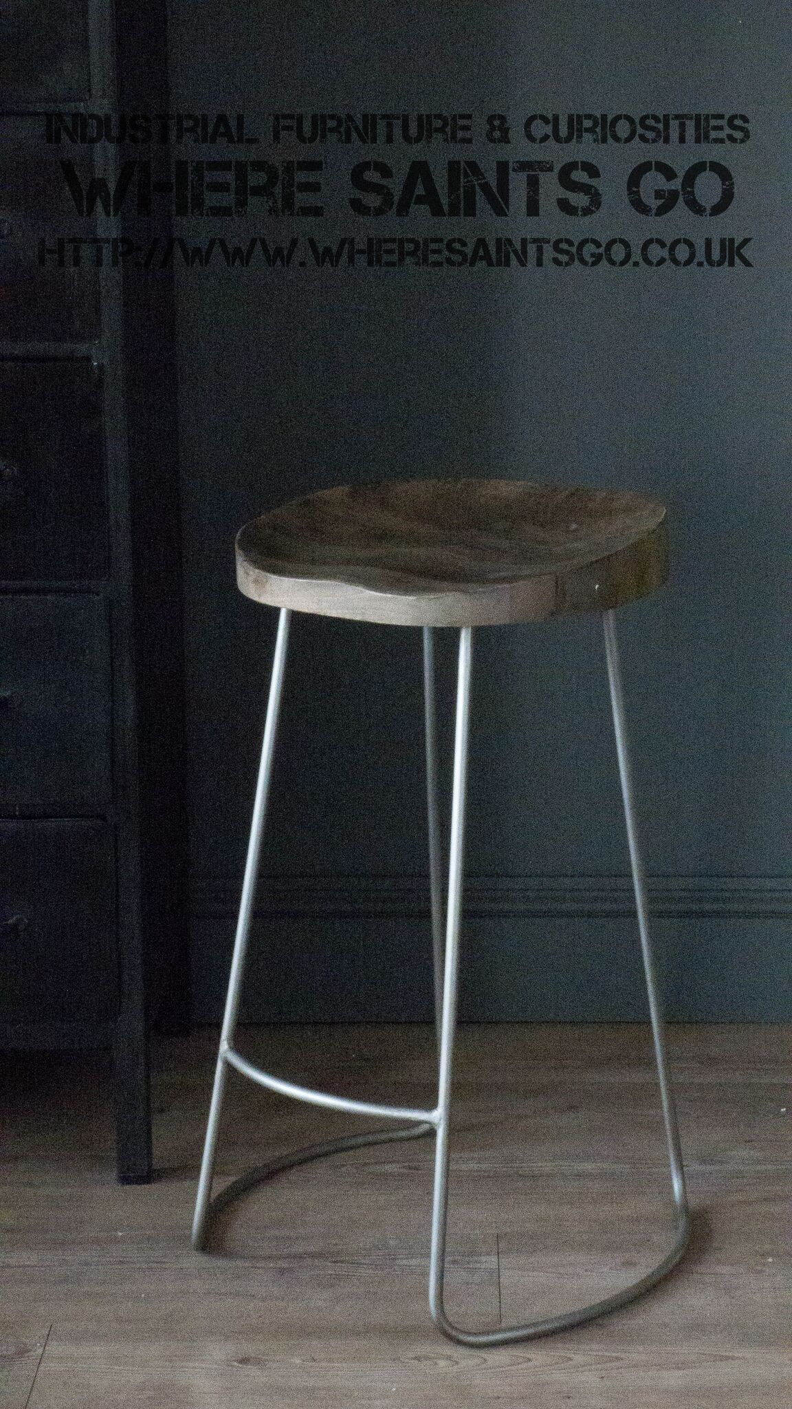 An Industrial Chic Stool With A Comfortable Wooden Seat And