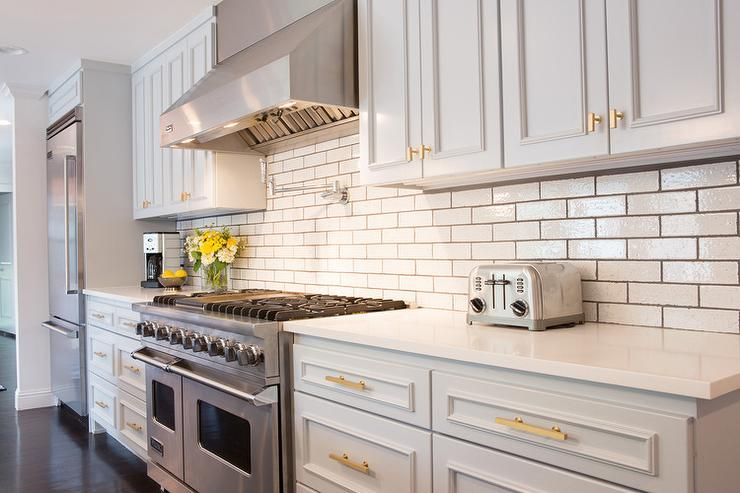Light Gray Kitchen Cabinets With Gold Hardware Transitional