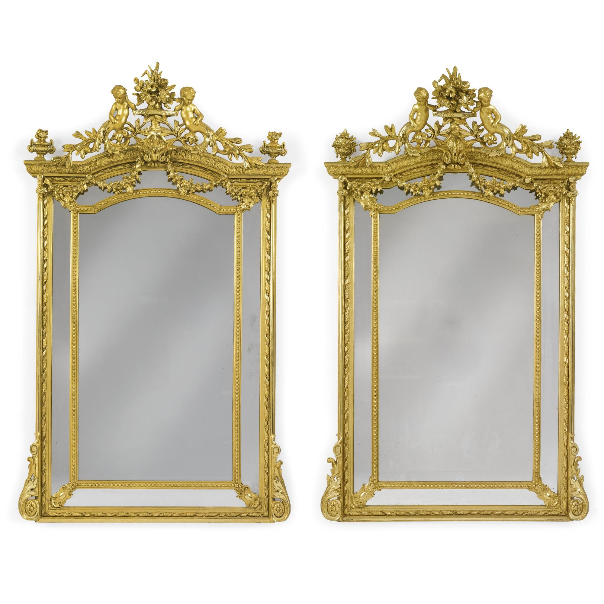 A pair of Régence style carved giltwood and composition pier mirrors ...