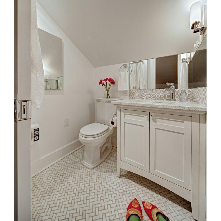 Small White Bathroom with herringbone pattern marble floor