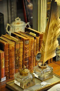 Quill and antique books