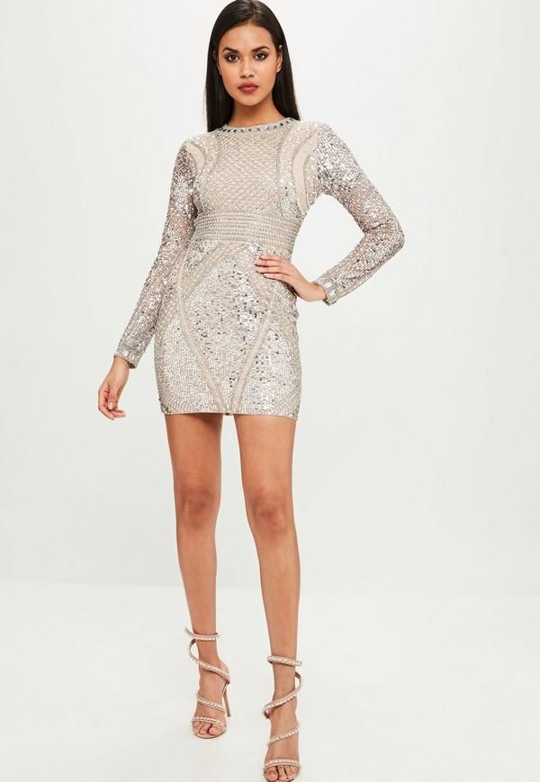 858bbcdc8279 This nude dress features an all over embellishment, mini length and long  sleeves.