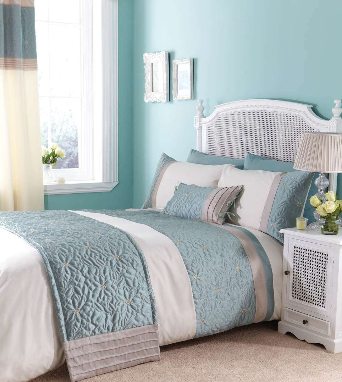 duck egg blue! love the big window, bedding and bedside cabinet