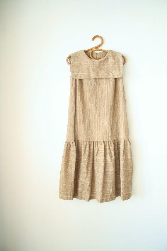 80s drop waist dress; slub cotton linen in an earthy shade of brown, sailor collar, sleeveless, ruffled skirt hem, back zipper.  Please take