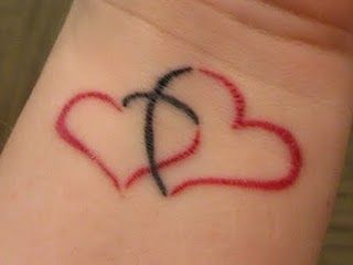 I am not really into tattoos, but I kind of like this one. Two hearts joined together by a cross - symbolizing Christ being the center of the relationship and also a visual representation of Christ completing each of us individually as well as bringing and keeping us together.