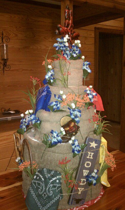 texas bithday cake, made with paper towel and toilet paper layers, bath towels and hand towel icing