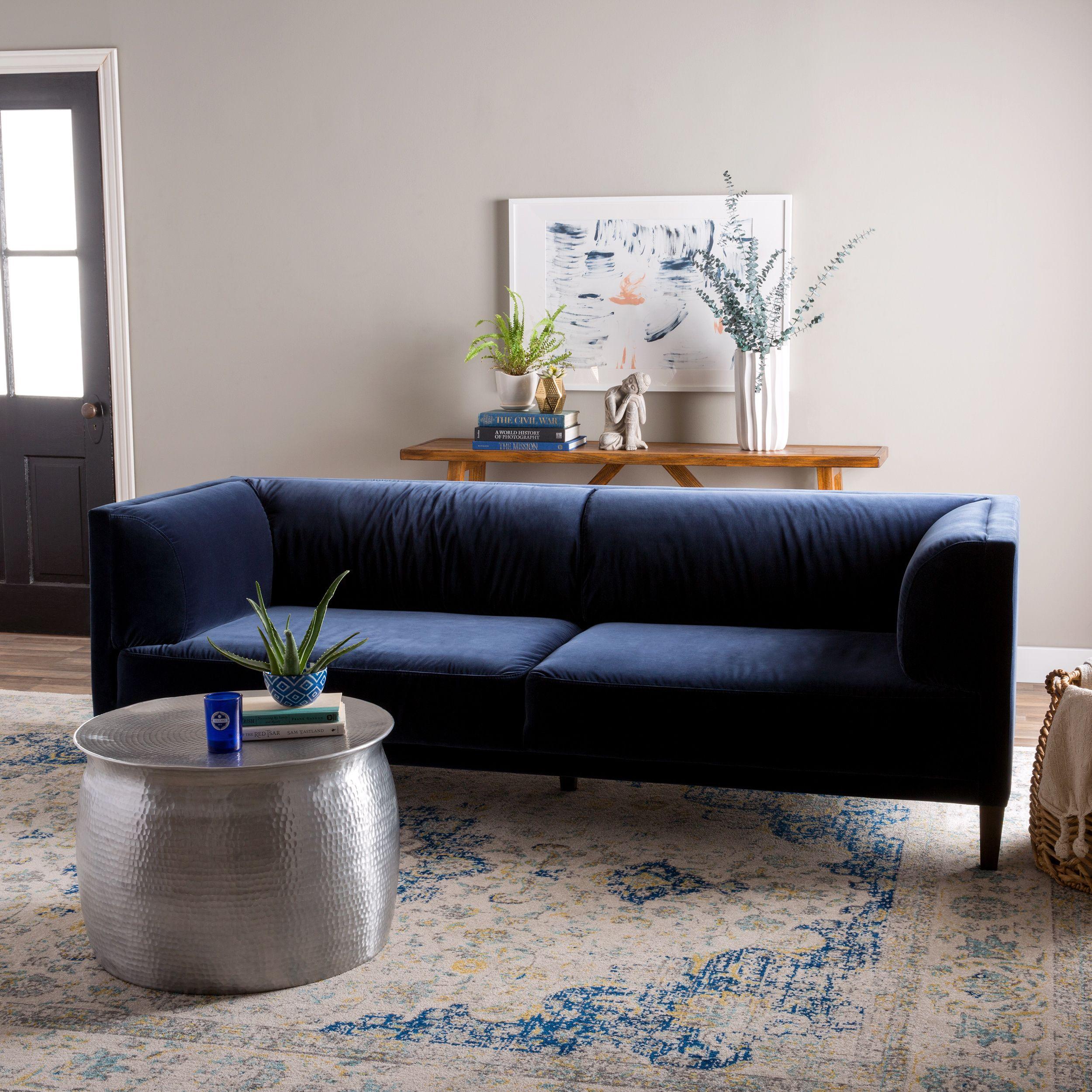 The nimbus velvet navy sofa creates a modern yet traditional focal