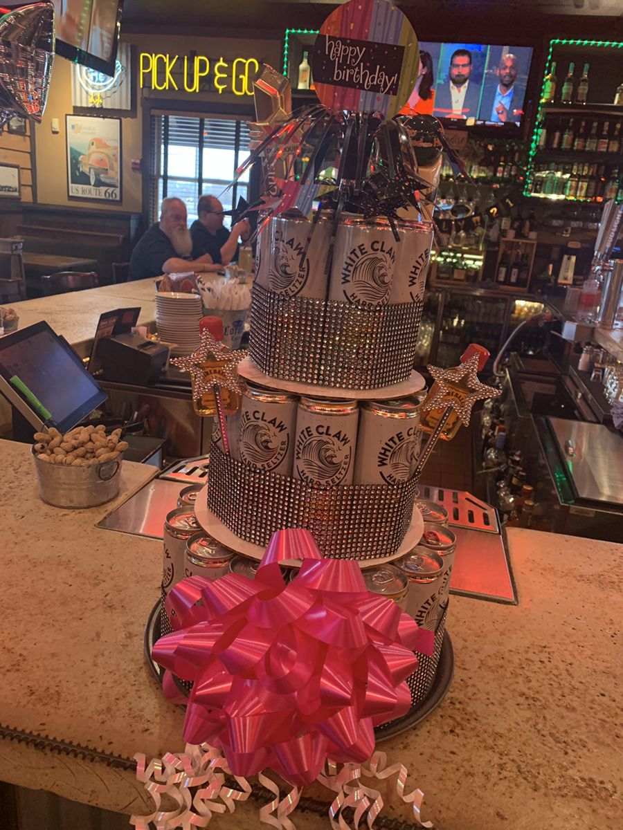3 tier white claw cake 4 packs of claws were used pizza