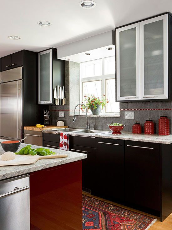 Frosted-glass cabinet doors trimmed with stainless steel ...