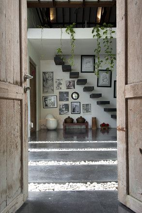 Entranceway of Valentina Audrito's Home Bali.A Tropical Rustic Modern dream house is a traditional joglo updated.