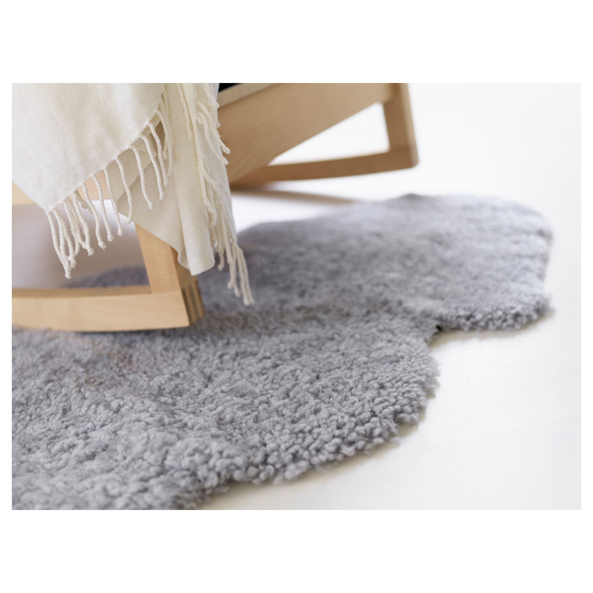 grey faux sheepskin rug plus rocking chair for home interior design ideas