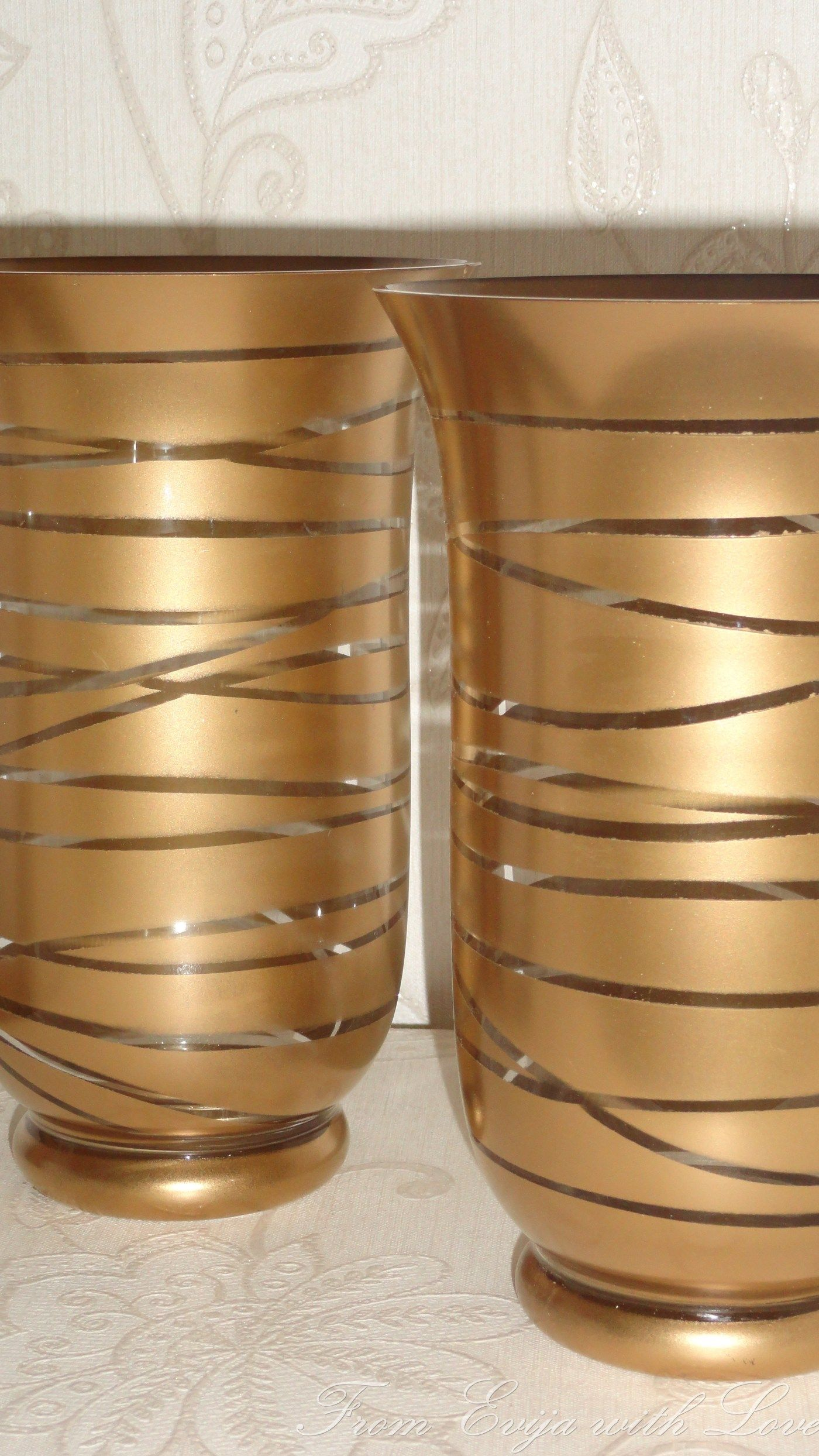 transform an old glass container into a beautiful piece using gold spray paint