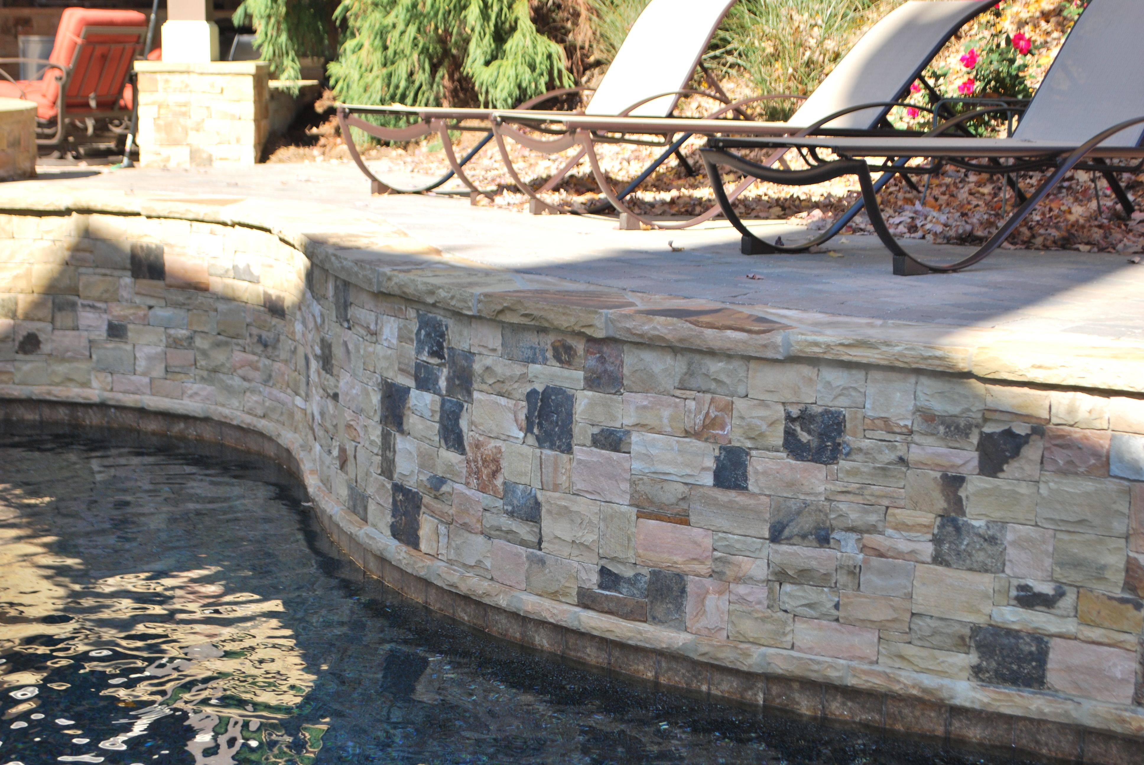 Raised Pool Wall Faced With Stacked Stone Hardscape