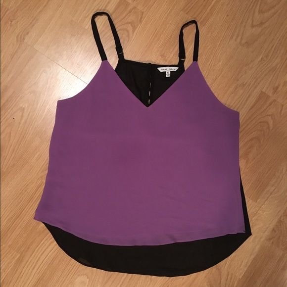 Purple and black tank Purple front; black back with buttons half way up the back; adjustable black straps; shorter style tank-not a crop; 100% polyester Naked Zebra Tops Tank Tops