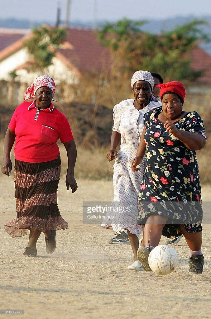 Women play a game of soccer in the Nkowankowa Township