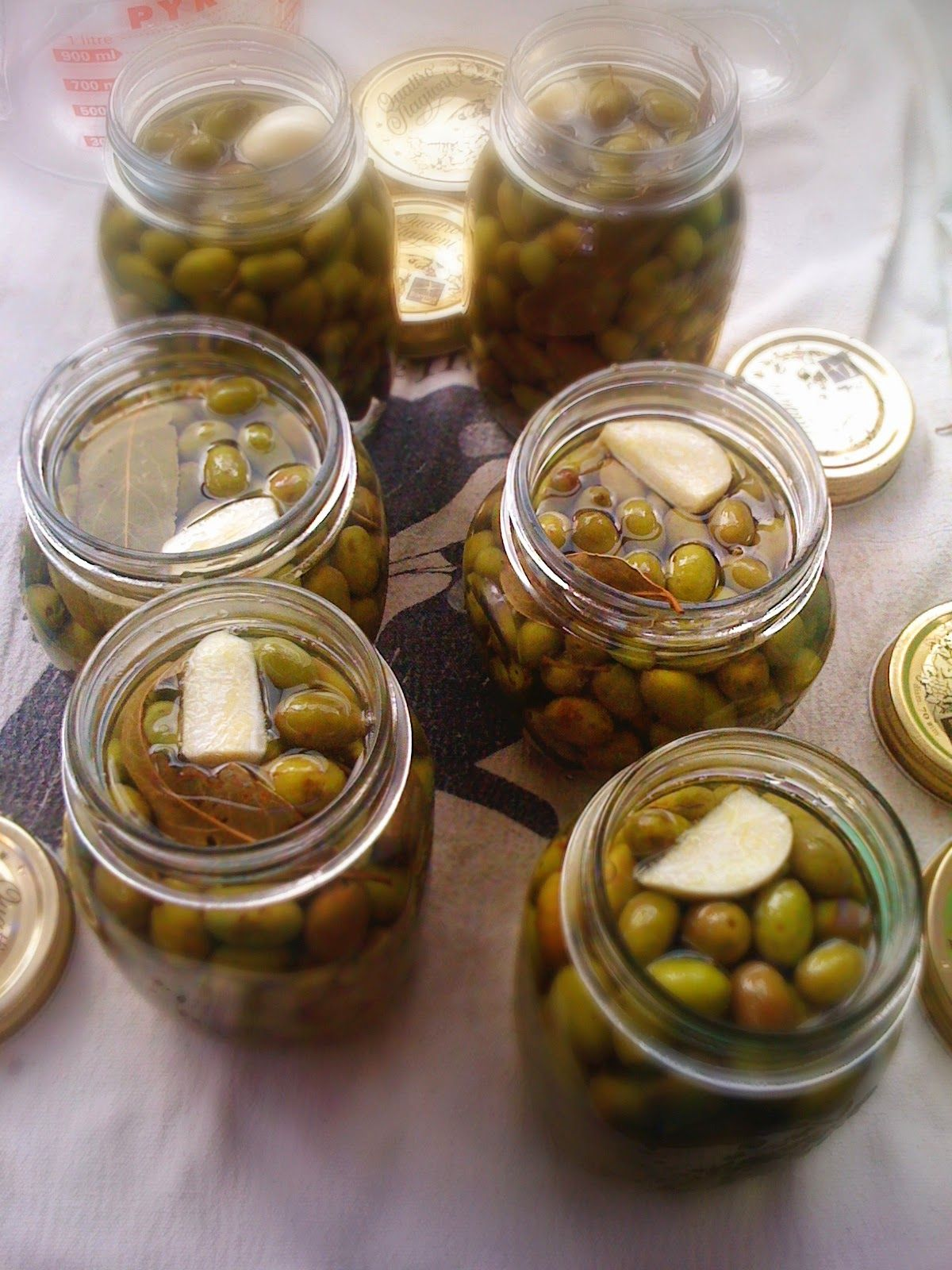 Picking, treating and preserving olives in brine, and olives marinated in olive oil and herbs #oliveoils