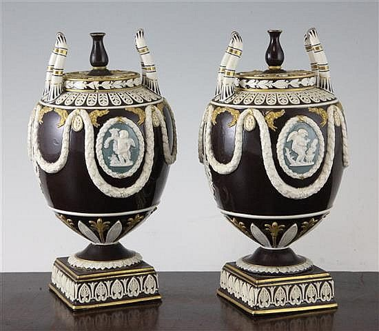 A Pair Of Unusual Wedgwood Drabware Neo Classical Vases And Covers
