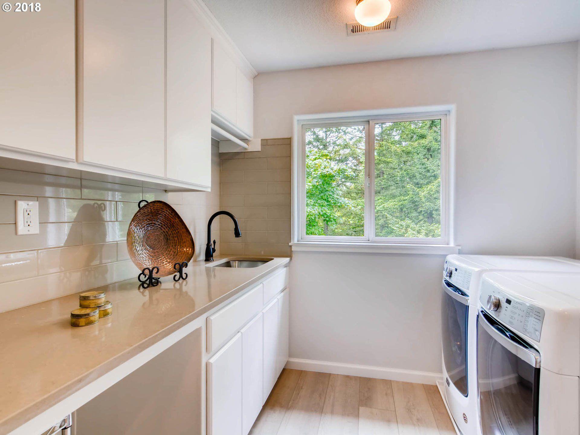 Laundry Room with Hayes Oak LVP by CoreTec Plus XL