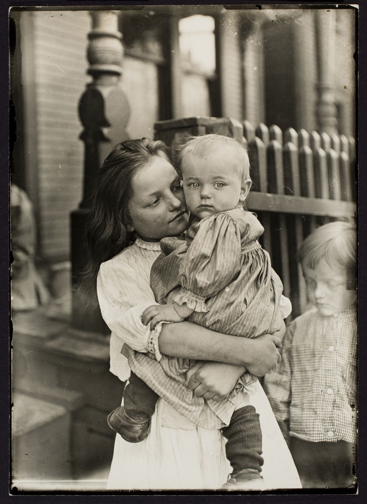 Little mother in the steel district, Pittsburgh, 1909