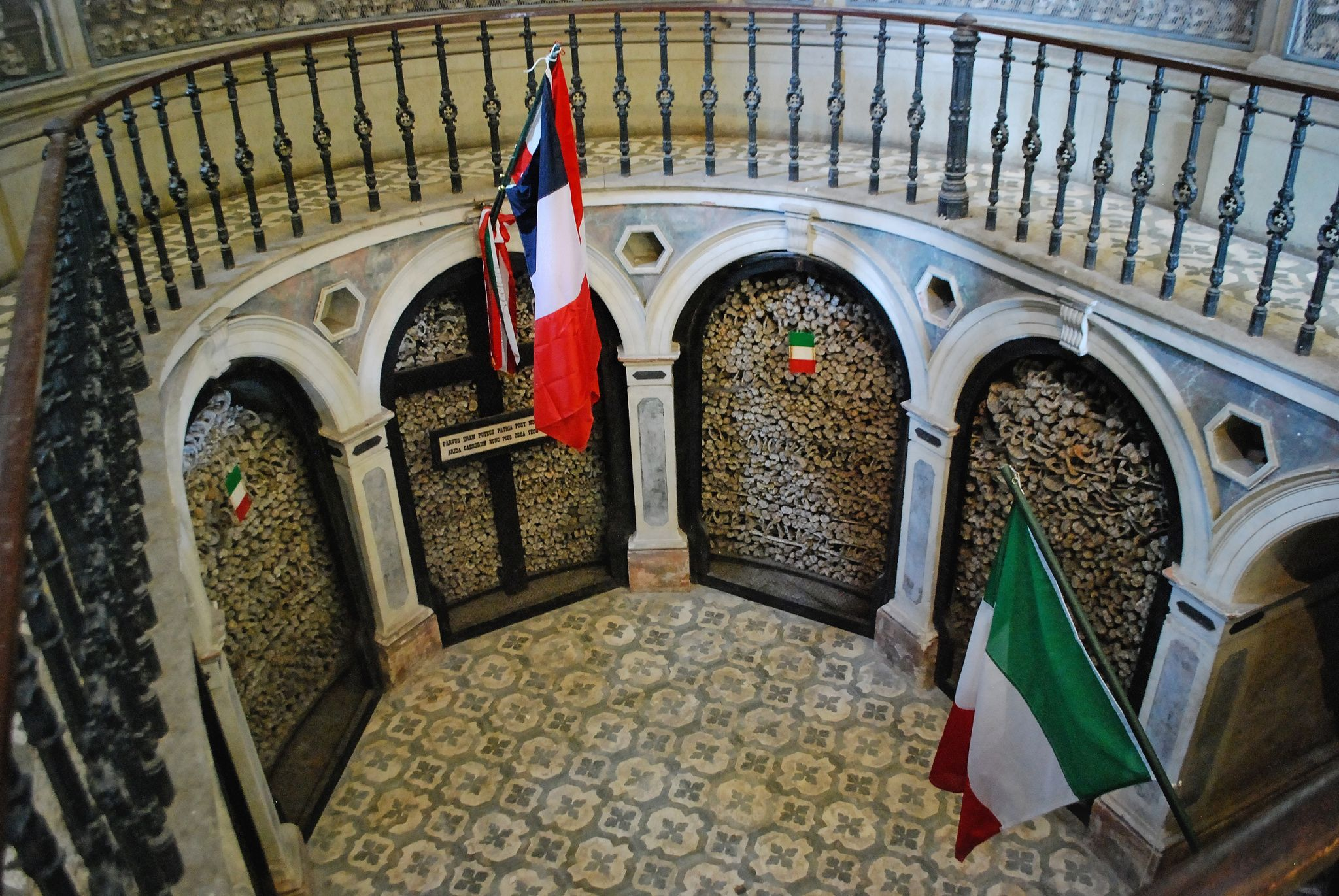 Bones and Flags - Chapel-Ossuary in Solferino, Mantova, Italy. It contains the remain of thousands of victims of the battle fought on 24 June 1869 between French and Sardinian Army against Austrian Army.