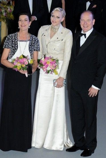 #Princess #Caroline of #Hanover posed next to Princess #Charlene of #Monaco and Prince Albert II of Monaco when entering the ball.