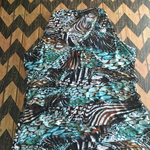Milano dressy tank top Milano dressy tank top with slight ruffle layers only worn 2 times Milano Tops Camisoles