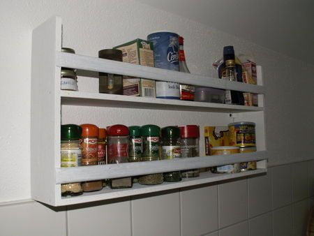 Shelf unit for wall made from bits of board.