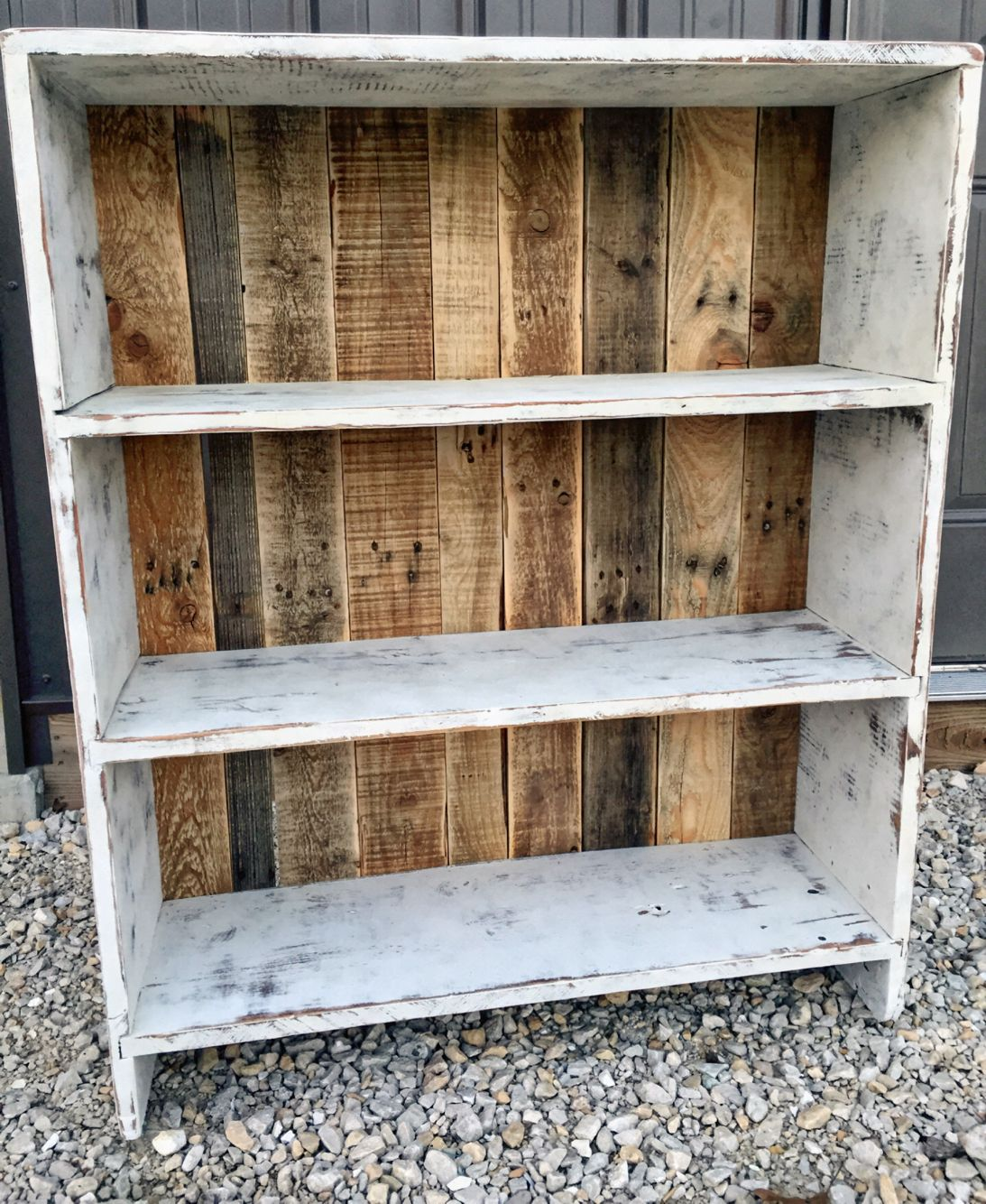 White Distressed Bookshelf With Pallet Backing