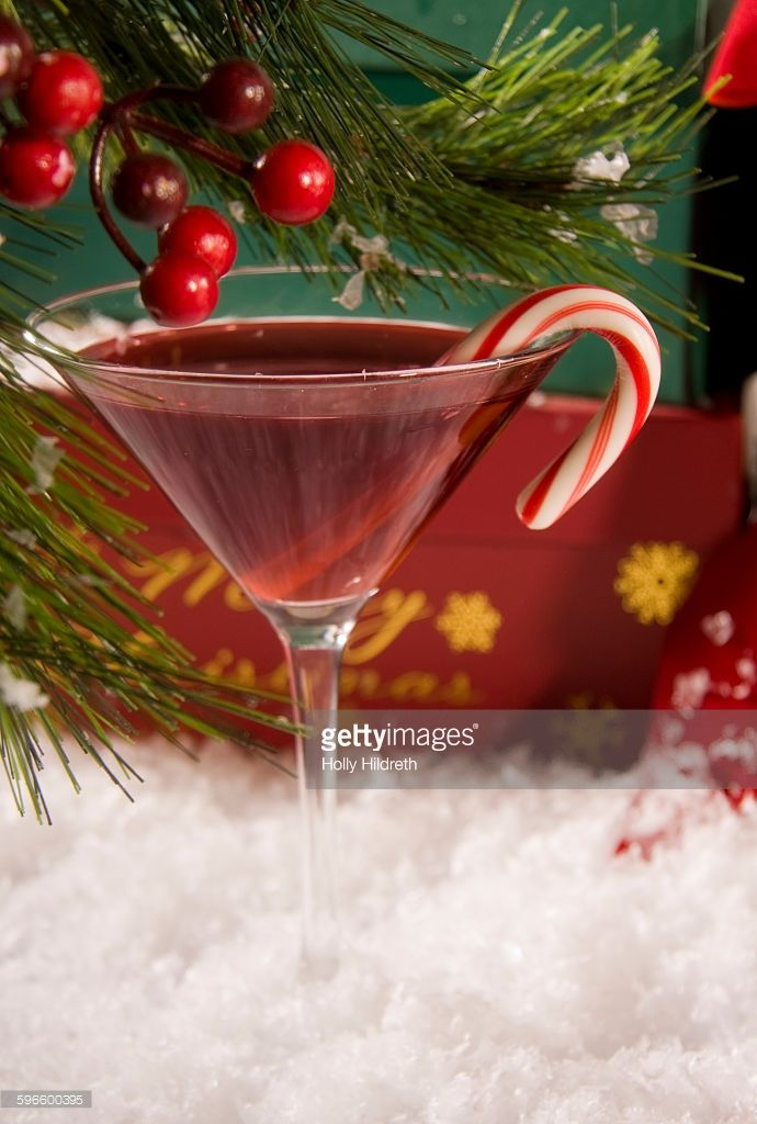 A Christmas Themed Martini With A Candy Cane Garnish Bachelorette Party Drinks Christmas Themes Fun Drinks