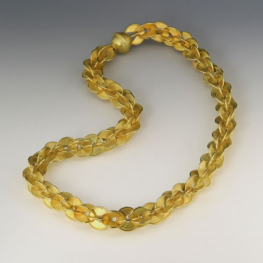 """Barbara Heinrich's Interlink necklace makes a big statement. In 18k yellow gold this skillfully crafted chain is rich in form and texture. We love the satin finish of the links contrasting the shiny finishes accentuating the curves of interlinking gold.<br><br>This necklace measures 17"""" long with a bayonet style clasp."""