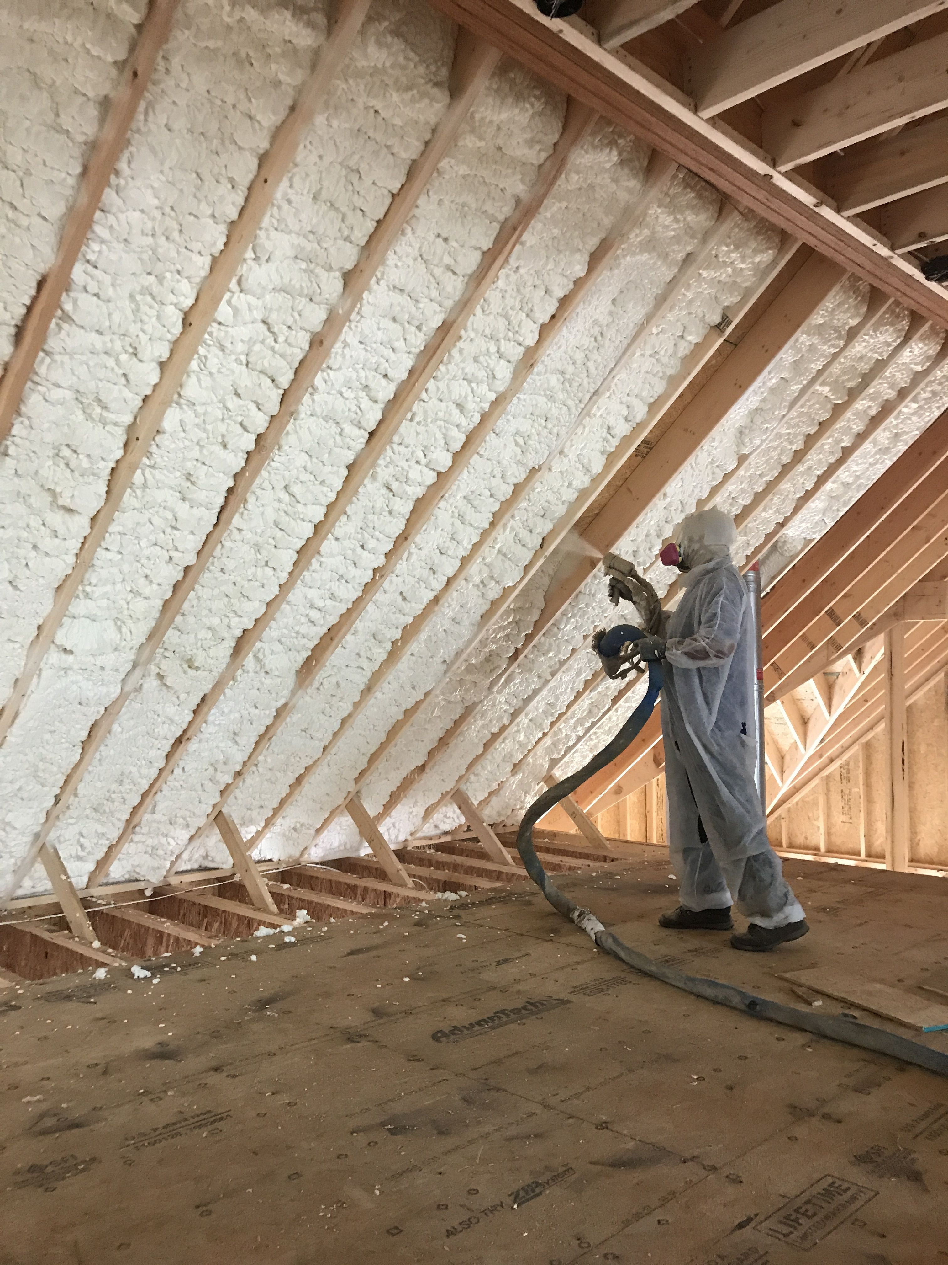 Spraying Open Cell Spray Foam Insulation On The Roof Deck And Walls Of A New Construction Home This Builder Is Ma Spray Foam Insulation Spray Foam Insulation