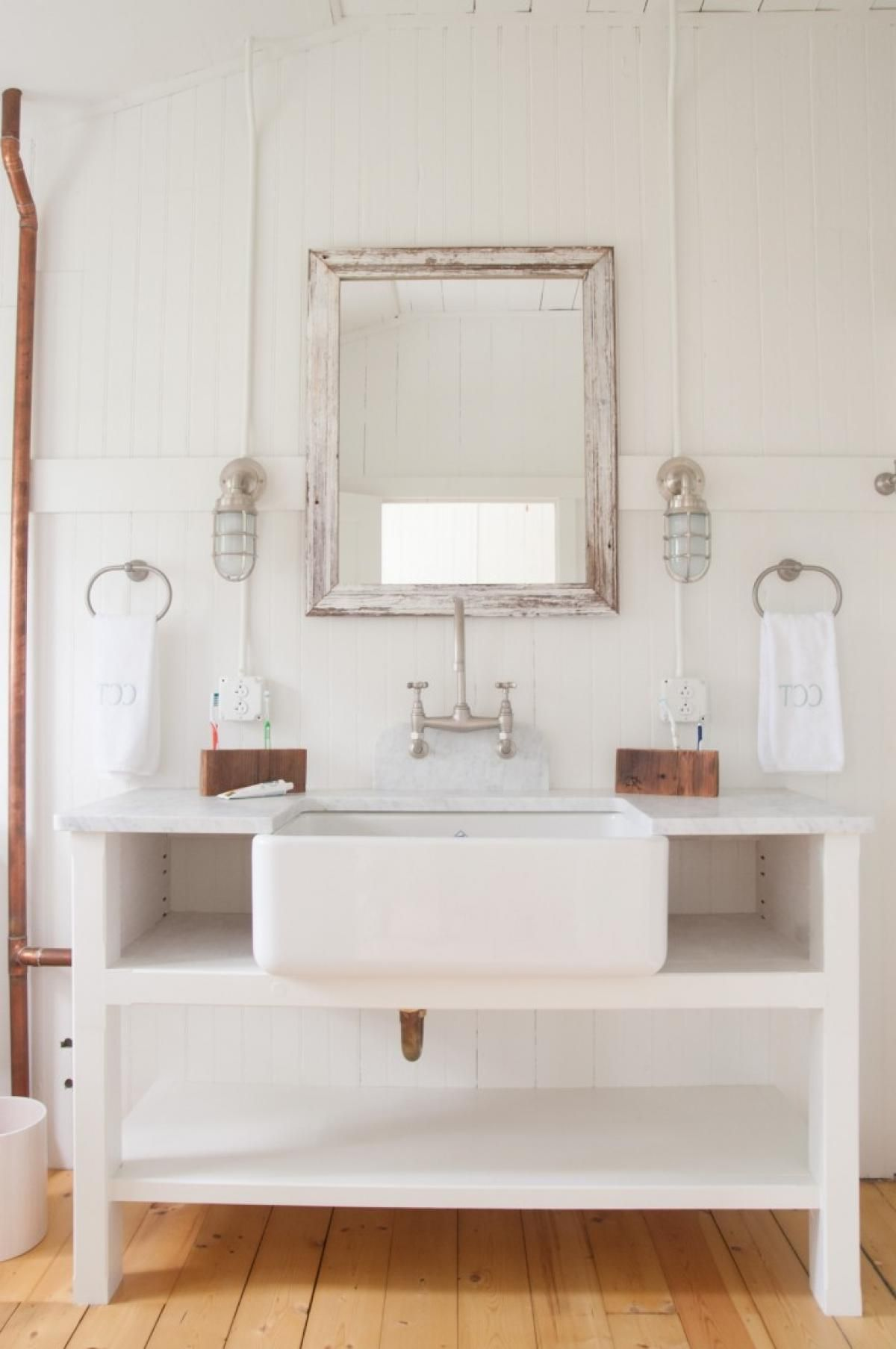 A Custom Built Vanity In The Master Bathroom Includes Open Shelving ...