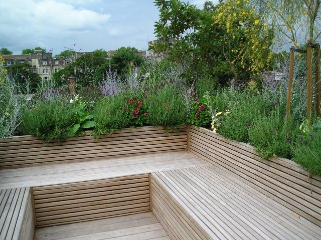 Roof terrace and benches made entirely of wood on a green roof Wooden decking  benches
