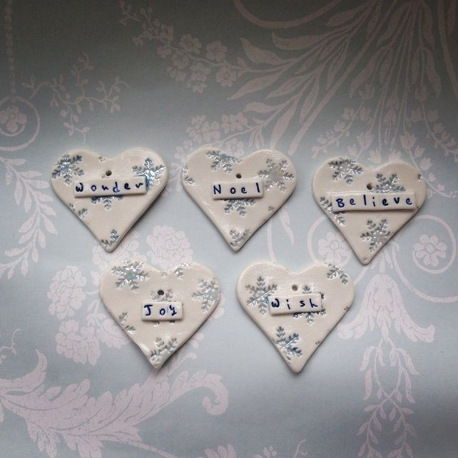Set of five porcelain Christmas hearts with snowflake and lustre detail. £19.99