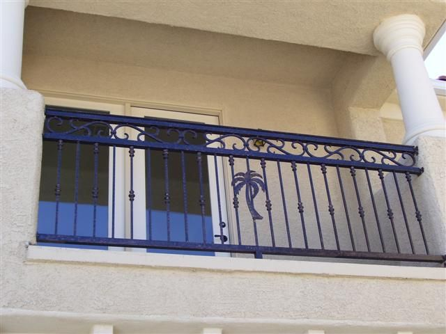 Balcony railings wrought iron balcony railing wrought for Terrace railing design
