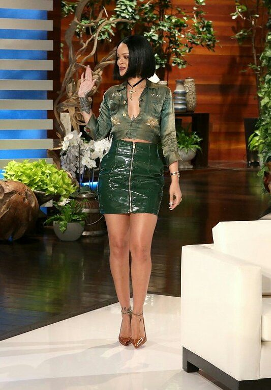 Rihanna wears an Alexandre Vauthier zipper-front patent leather miniskirt, a vintage army-style jacket from What Goes Around Comes Around, and Christian Louboutin python stilettos