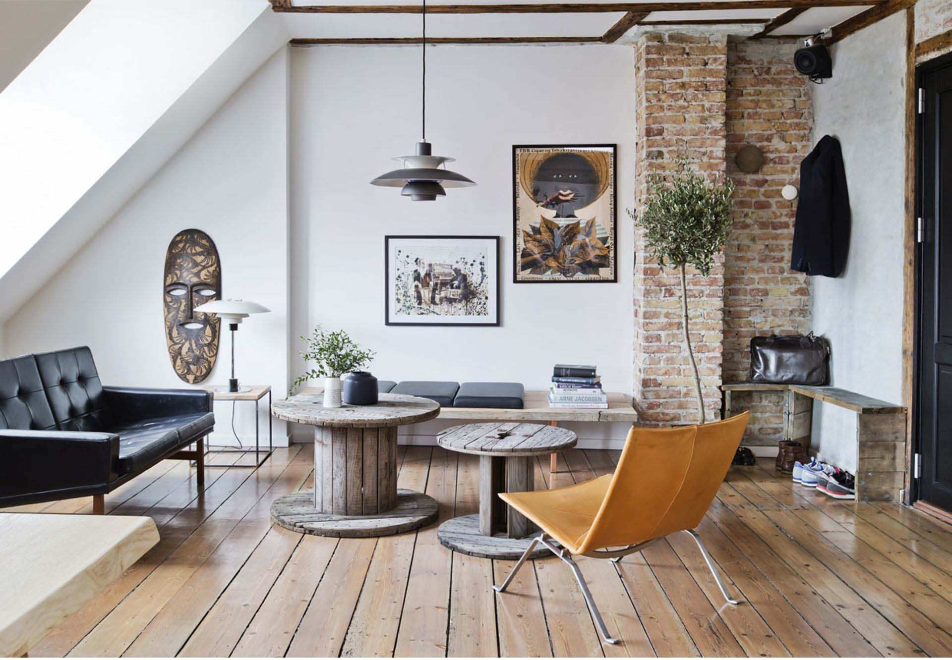 A masculine style apartment with exposed brick and recycled wood home of michael lauritzen owner of the good wood is located in copenhagen denmark