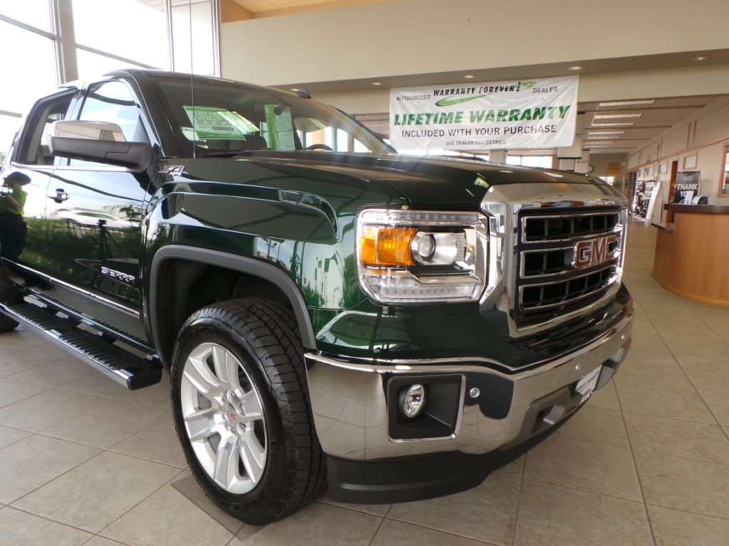 Shimmering Emerald Green Metallic Paint On The 2014 Gmc Sierra